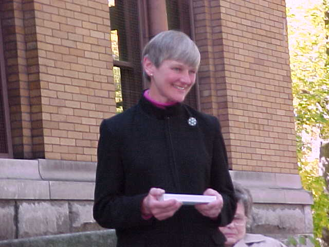 Margaret Thomson on steps  of the Andrew Carnegie Free Library