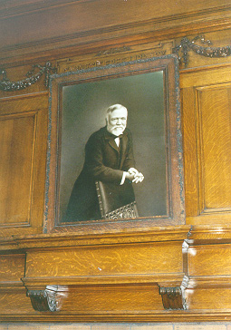 Portrait of Andrew Carnegie hanging over fireplace in Andrew Carnegie Free Library, Carnegie, Pa.